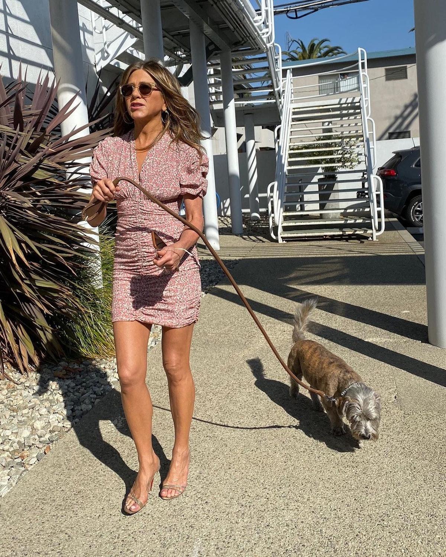 Jennifer Aniston walking her dog.