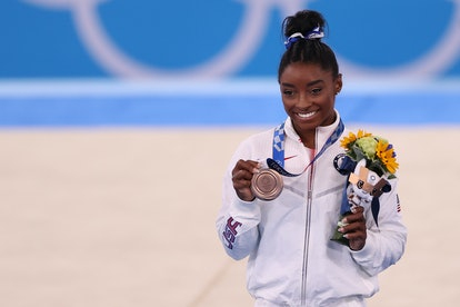 Simone Biles of Team United States poses with the bronze medal during the Women's Balance Beam Final...