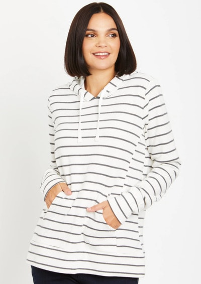Woman standing, modeling white hoodie with grey stripes
