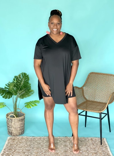 Woman standing; modeling black t-shirt dress
