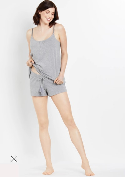 Woman modeling grey two-piece pj set with shorts and tank