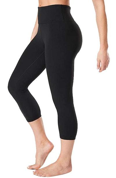 Waist-down photo of model wearing black high-waisted crop leggings