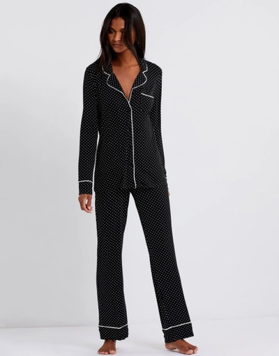Woman modeling two-piece black pajama set
