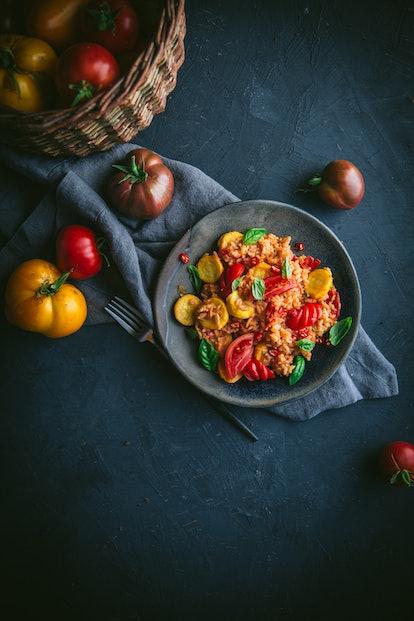 tomato summer squash stir fry in stone bowl