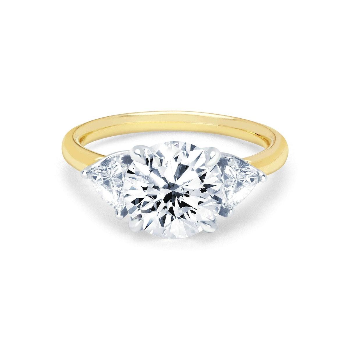 Round Diamond Setting with Side Trillion Diamonds from Logan Hollowell.