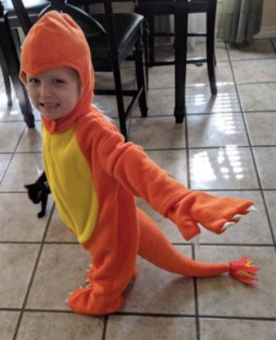 Child wearing a Charmander costume