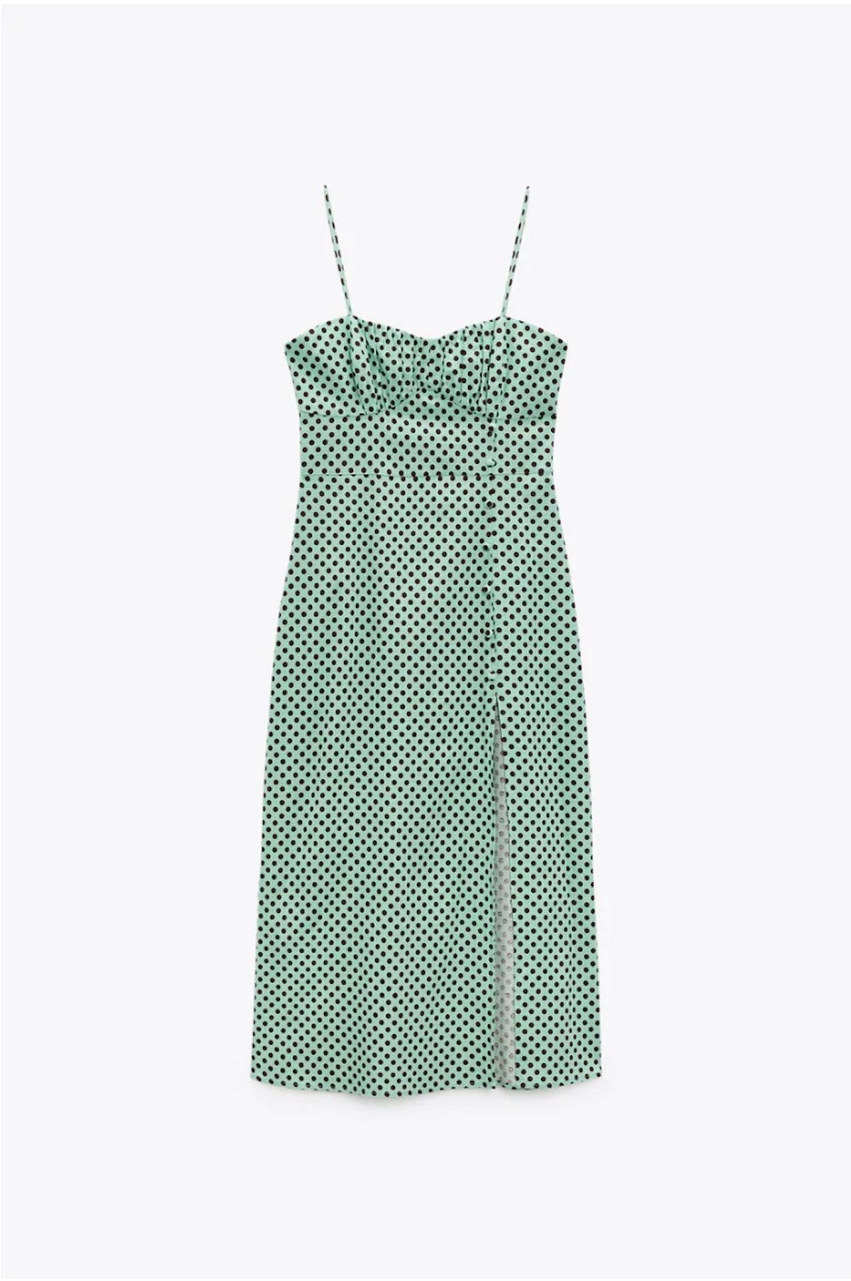 Zara's green and white linen blend polka dot dress.