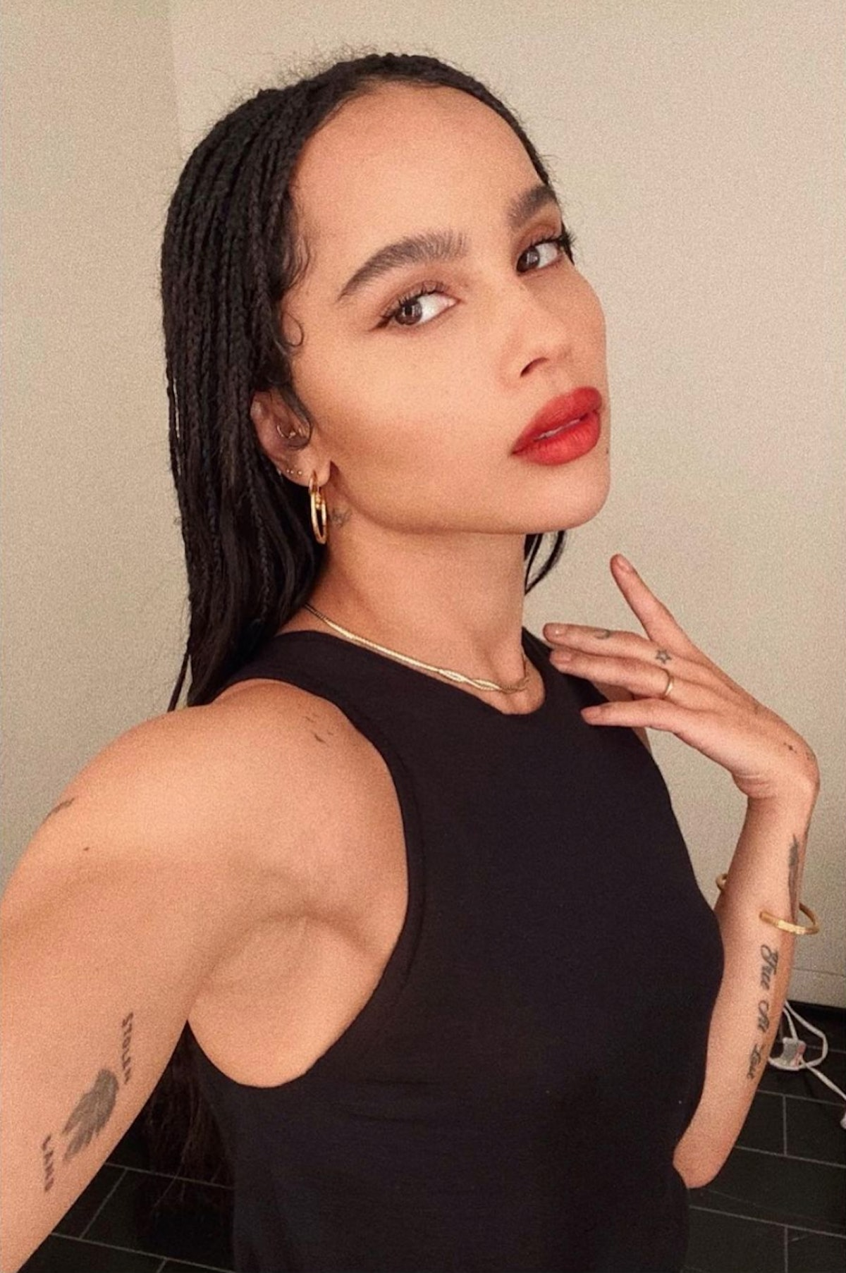 Zoe Kravitz wearing YSL's red lipstick and simple gold jewelry.