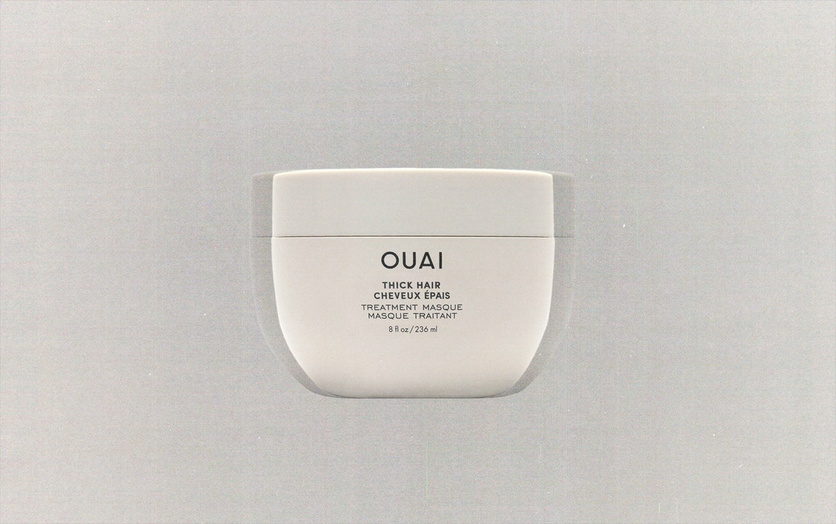 a tub of Ouai hair mask against a grey background
