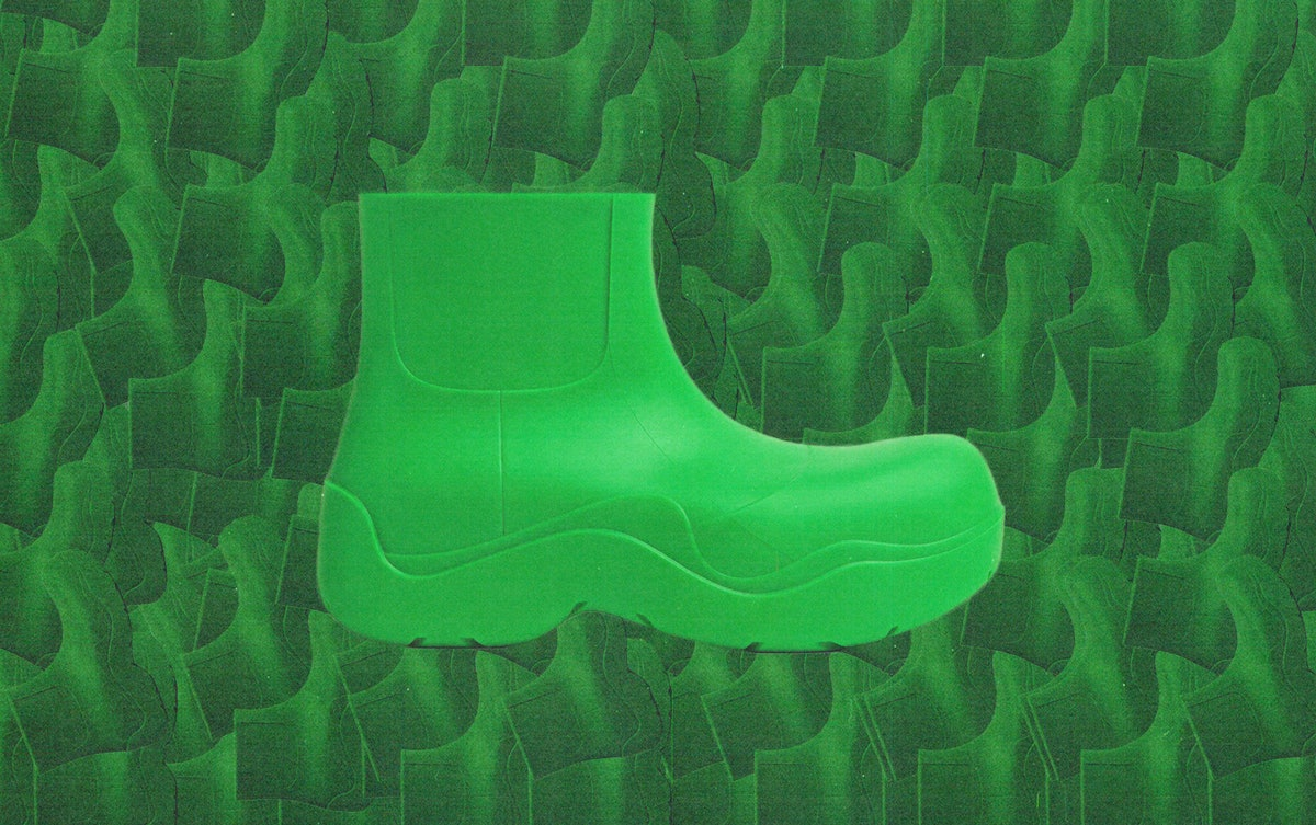 a lime green rubber ankle boot designed by bottega veneta against a textured green background