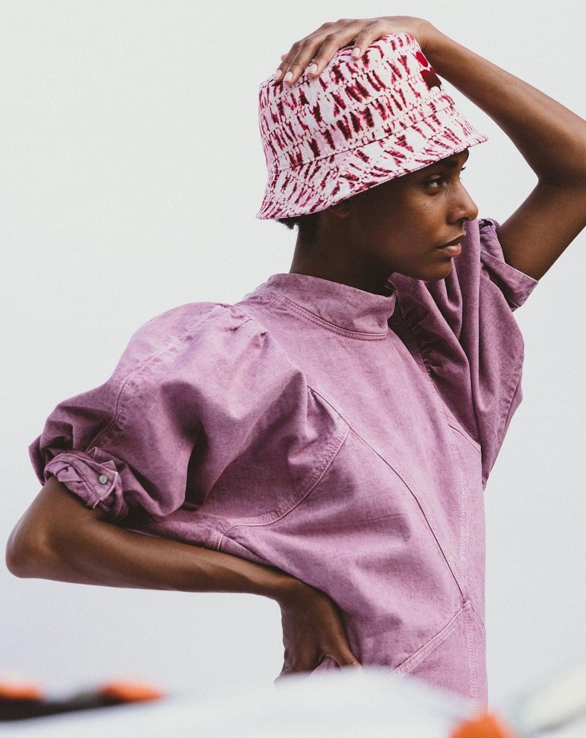 Model wearing Isabel Marant bucket hat.