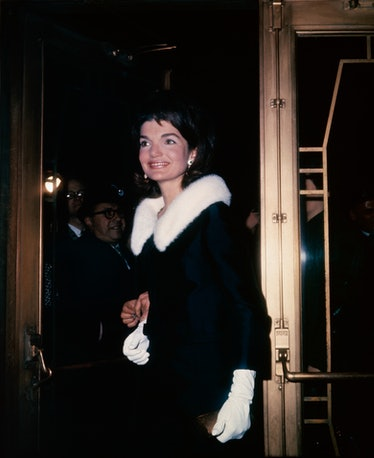 Jackie Kennedy wearing a coat with a fur ruff