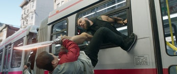 Shang-Chi (Simu Liu) does his best to avoid Razor Fist's (Florian Munteanu) wrath