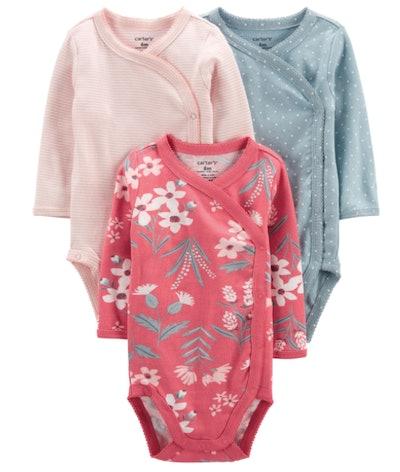 Pink, floral, and teal long sleeve onesies