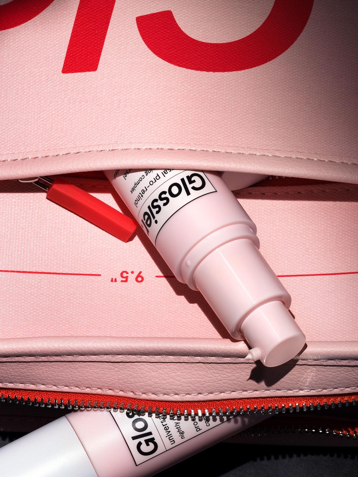 Glossier Universal Pro-Retinol peeking out of bag