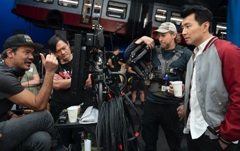 Director Destin Daniel Cretton and actor Simu Liu on the set of Shang-Chi and the Legend of the Ten ...
