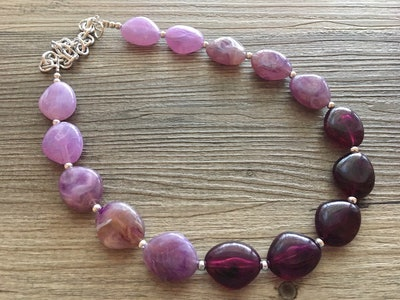 A purple statement necklace is one accessory to use for a Phyllis Lapin-Vance Halloween Costume.