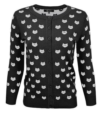 A black and white cardigan with cats on it completes an Angela Martin Halloween costume.