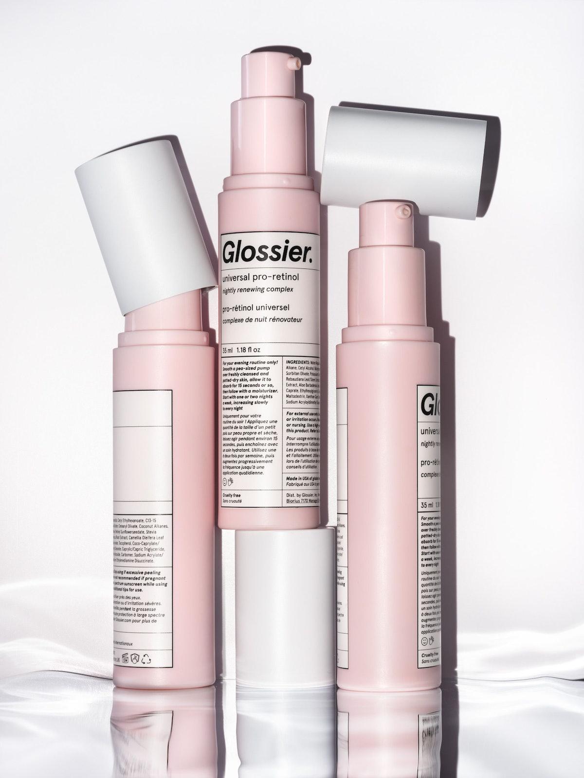 Glossier Universal Pro-Retinol bottles stacked up stylistically