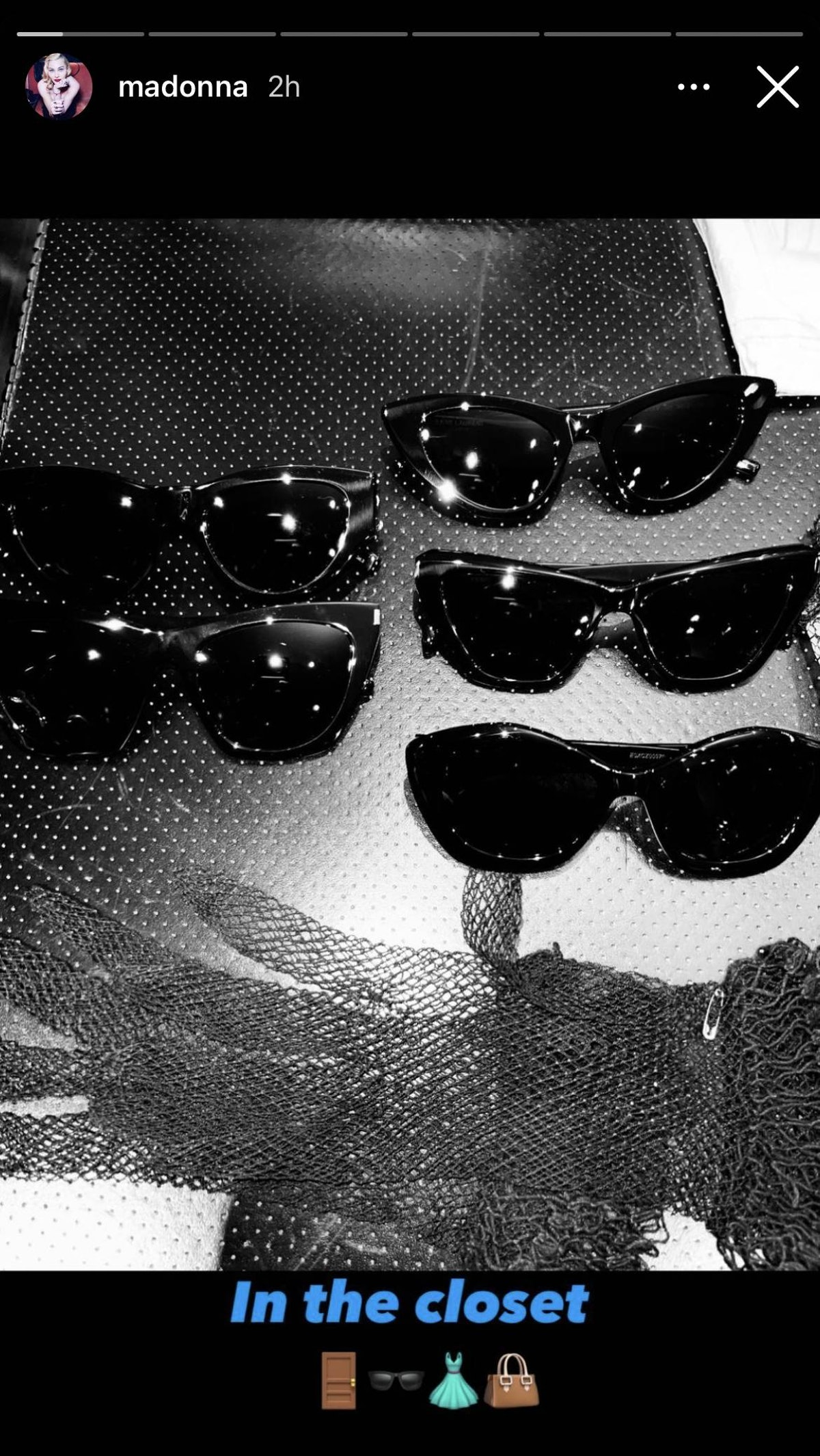 Madonna's black sunglasses collection in a tray.