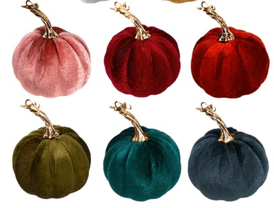 Image of six small, decorative velvet pumpkins in pink, reds, green and blue colors