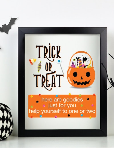 please take one halloween sign- jack o lantern with the words trick or treat written