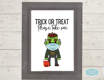 please take one halloween sign featuring Frankenstein cartoon in a health face mask