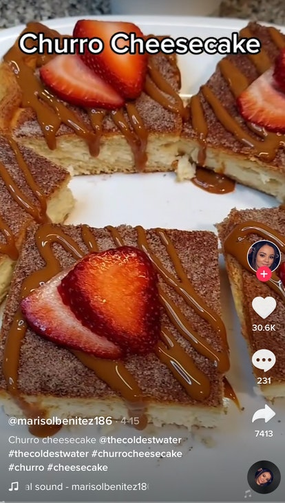A plate of churro cheesecake bars from TikTok sits on a plate with strawberries on top.