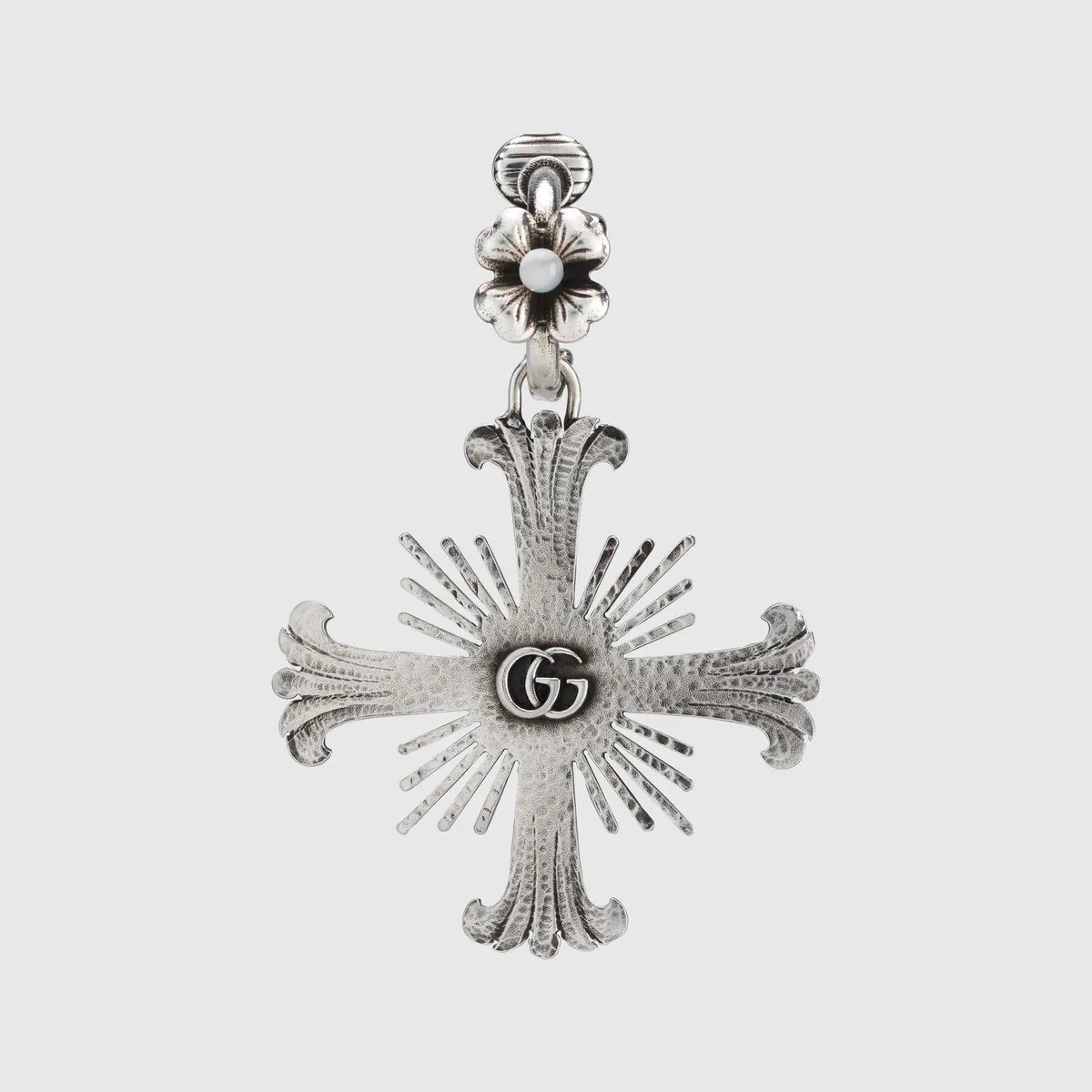 Single unisex earring with flower and cross from Gucci.
