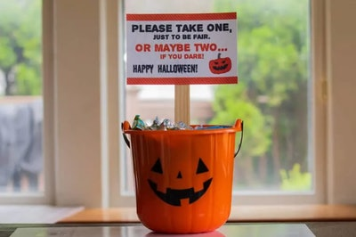 please take one halloween sign- small, held up by popsicle stick