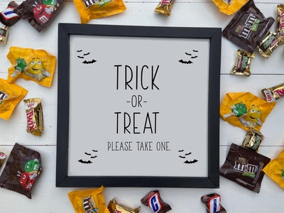 please take one halloween sign- framed with small bat graphics in the corners