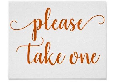 please take one halloween sign written in orange large script
