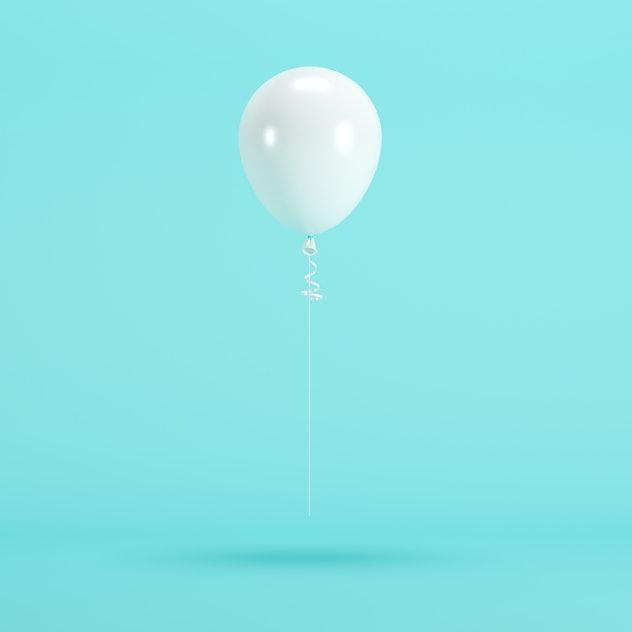 white balloon floating on blue background