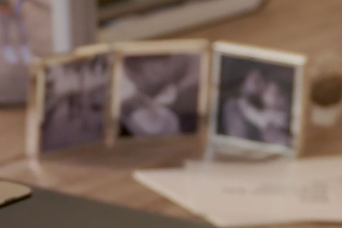 Blurry close-up of three indistinguishable black and white photos on Meghan Markle's desk