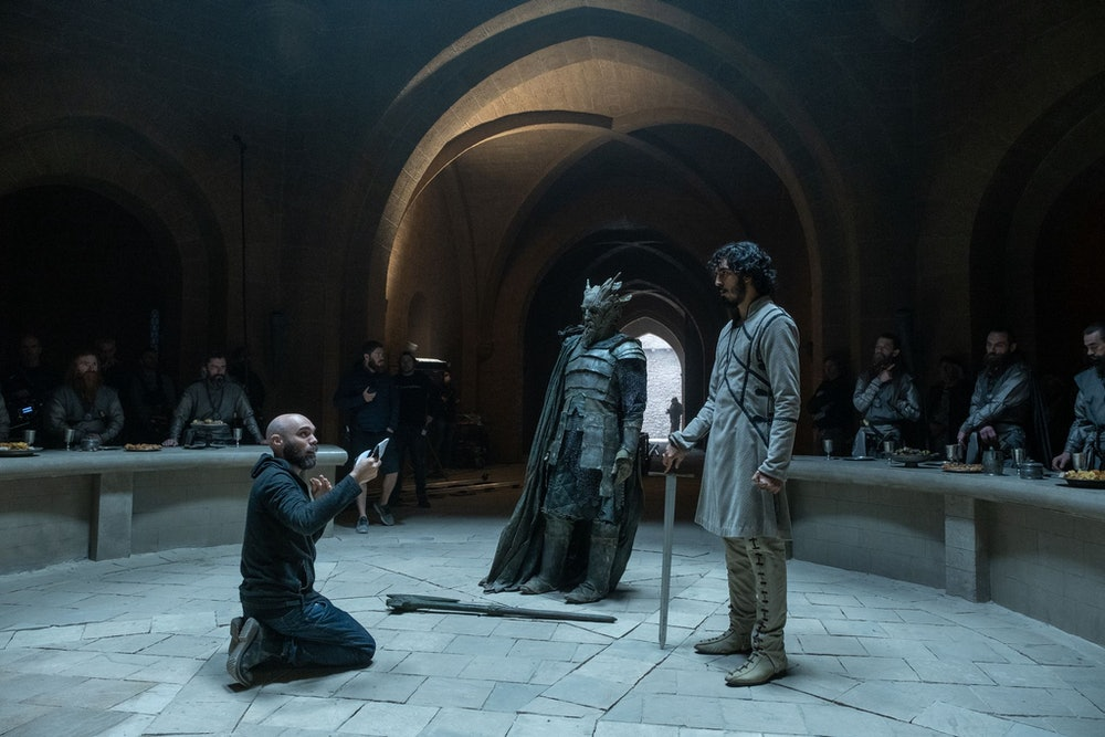David Lowery directing actors Dev Patel and Ralph Ineson on the set of The Green Knight