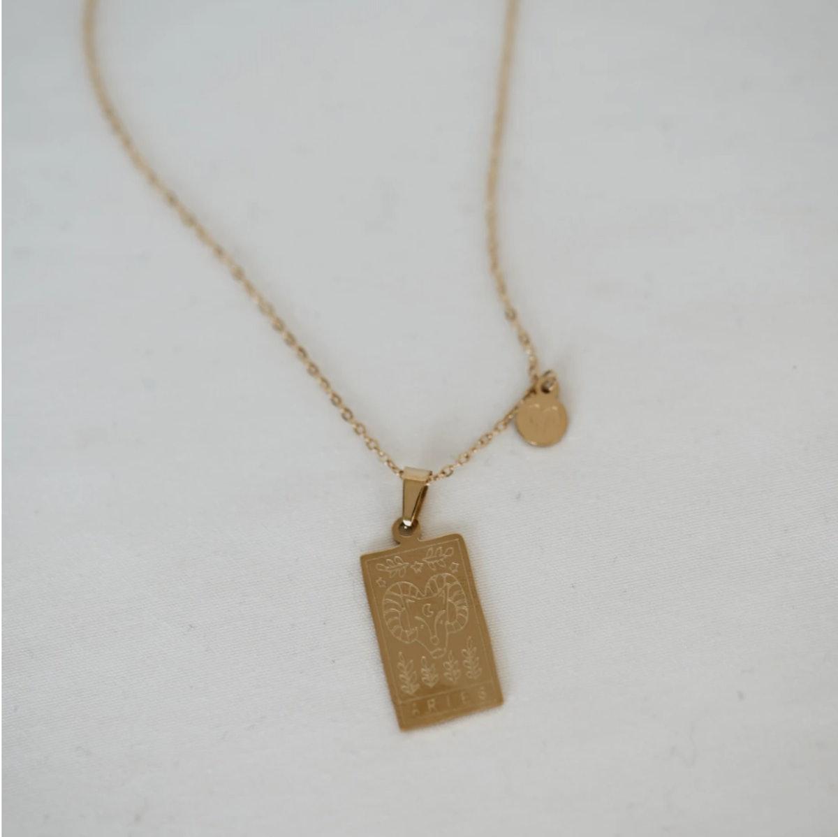 Stella & Haas' zodiac card necklace.
