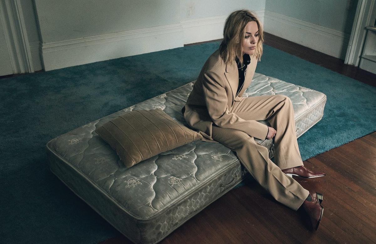 Margot Robbie on a bare mattress.