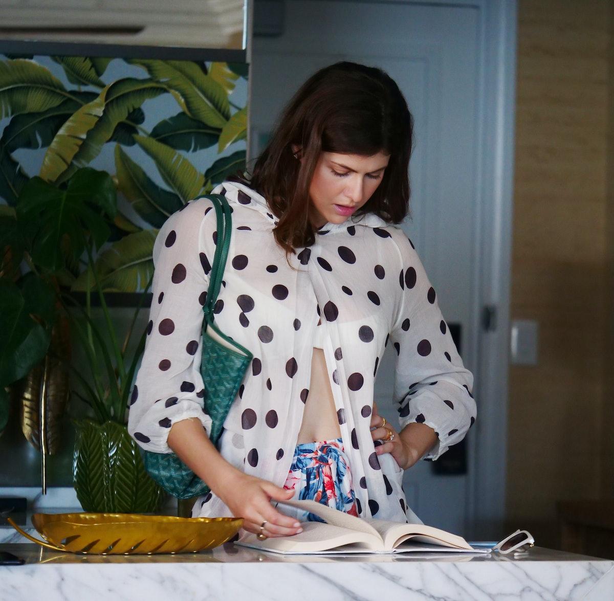 Alexandra Daddrio looking at a book