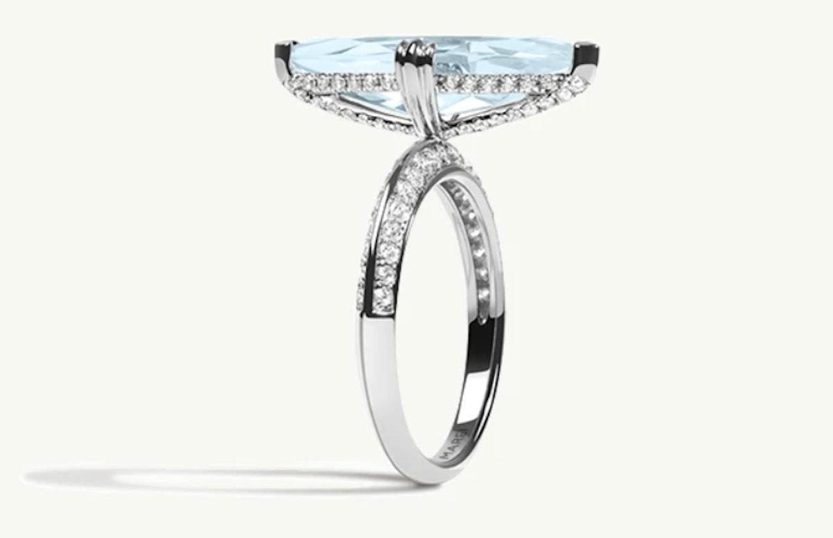 "MAREI Pavé Diamond ""Halo"" Engagement Ring with an aquamarine center."