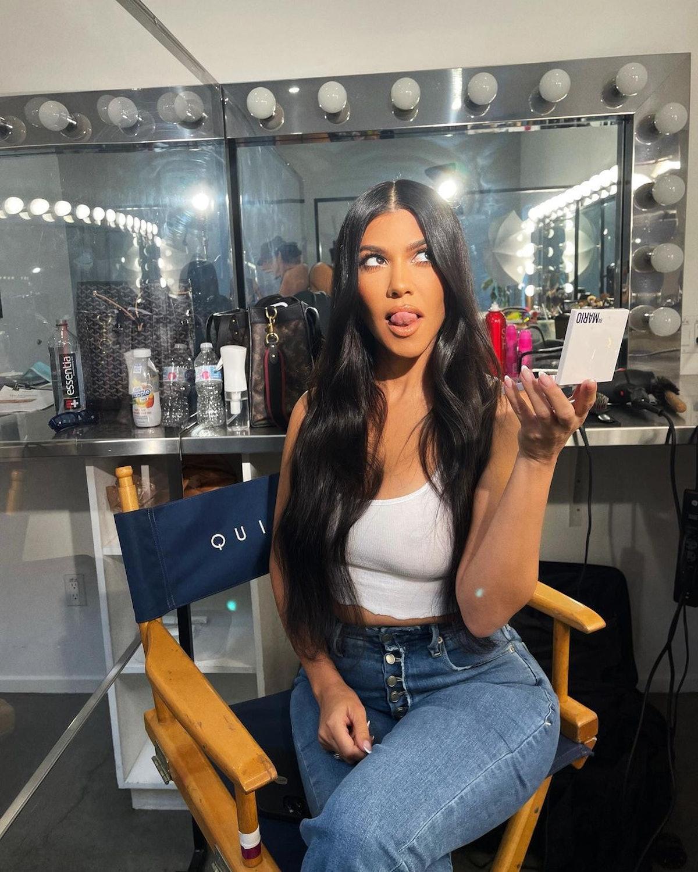Kourtney Kardashian sitting in director's chair on Instagram
