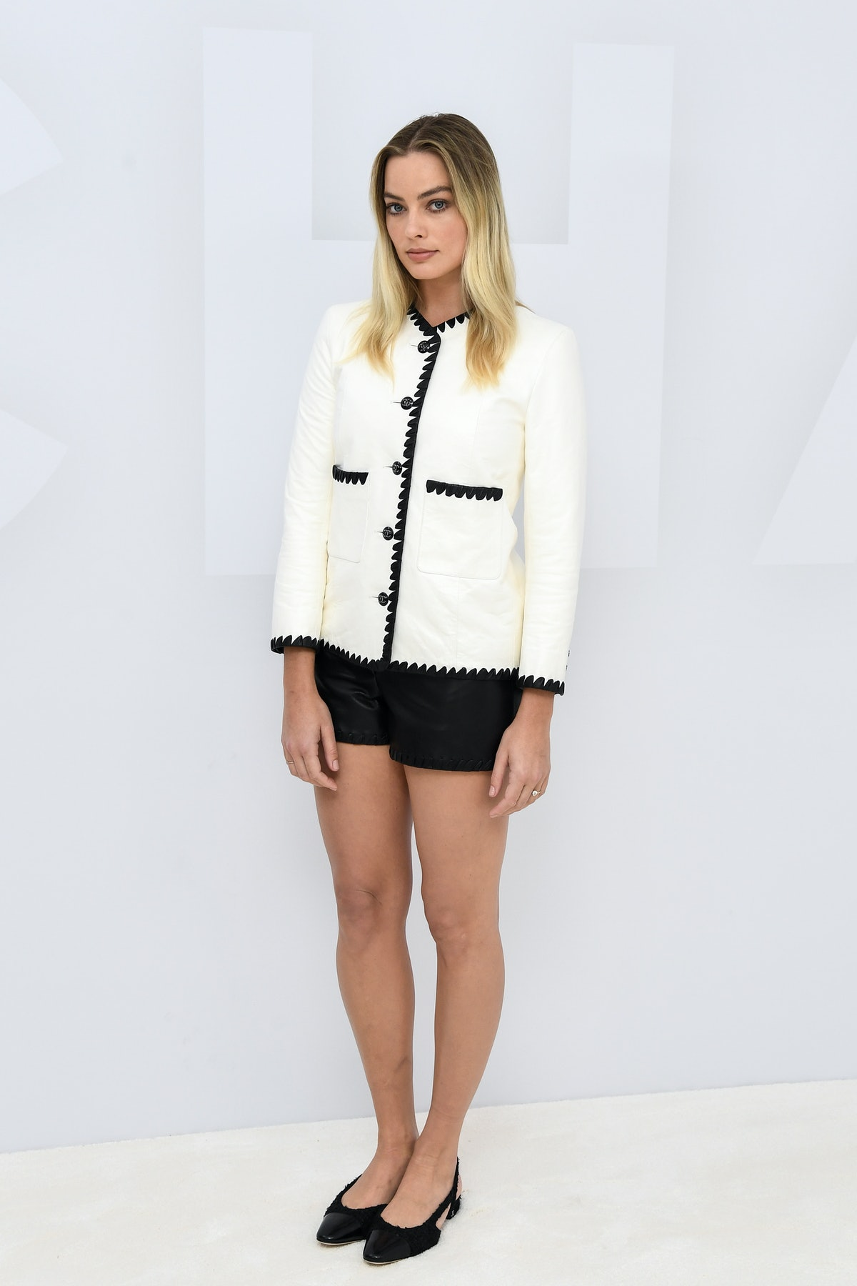 Margot Robbie in Chanel suit.