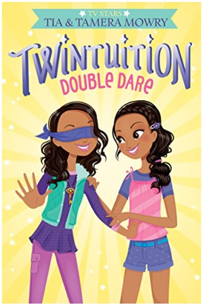 Book cover; twin girls smiling, one with blindfold over her eyes