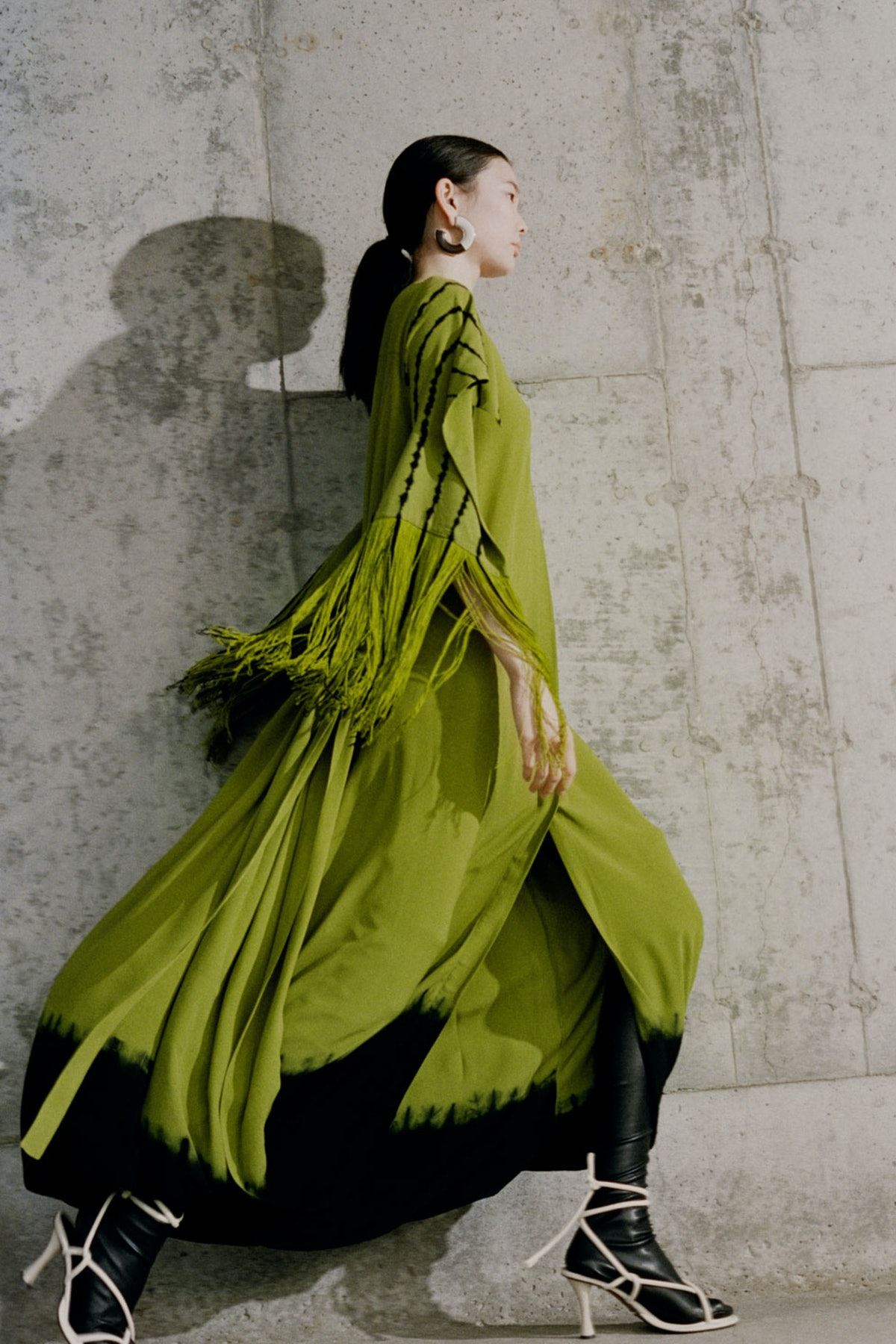 Model wears Proenza Schouler Fall/Winter 2021 collection.