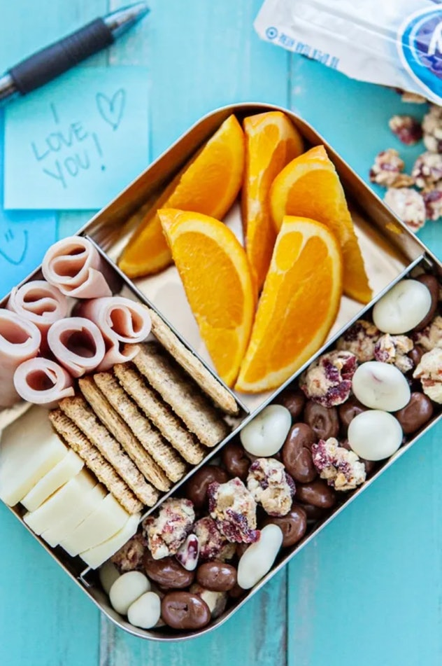 lunch box with cold cuts and snacks