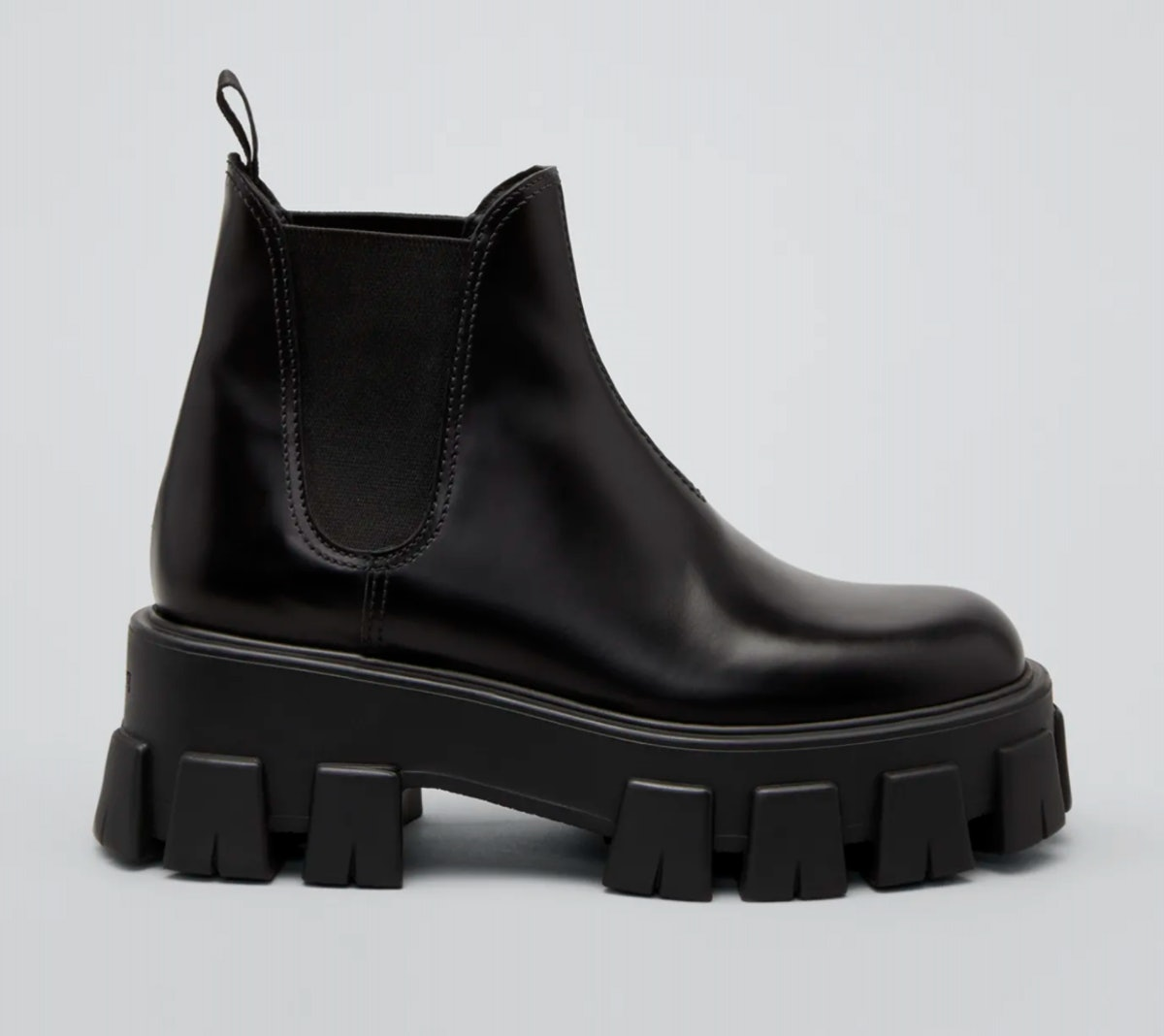 Prada's Leather Lugged-Sole Chelsea Boots in black.
