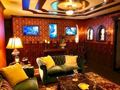 The main lounge in the Airbnb inspired by Disney's Haunted Mansion are ghostly illusions like changi...