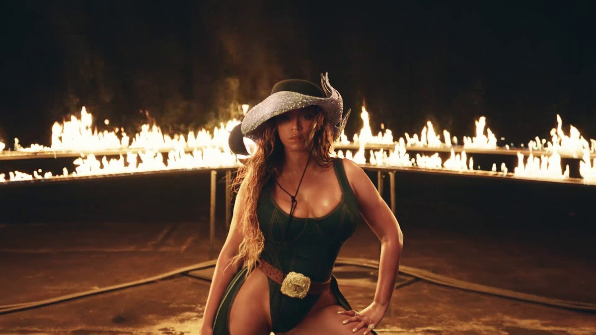 Beyoncé surrounded by an enflamed rodeo