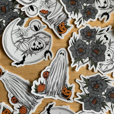 Halloween stickers in a pack of three, one ghost, pumpkin flowers, and moon
