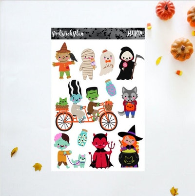 cute halloween stickers featuring smiling characters