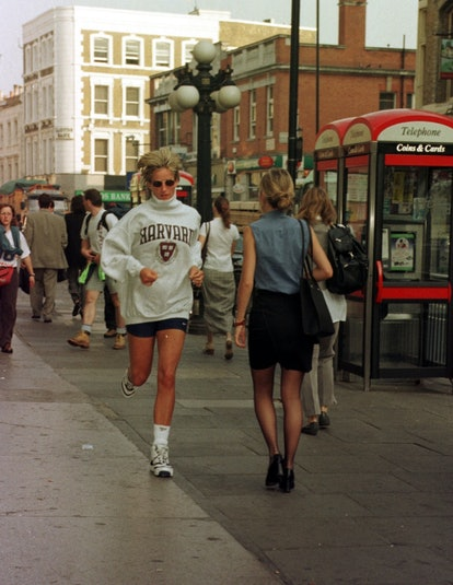 Diana, Princess of Wales, jogs along the High Street to her car after her gym session in West Kensin...